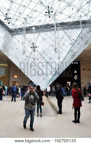 PARIS - April 16: People inside the Louvre Museum (Musee du Louvre) on April 16, 2017 in Paris, France.