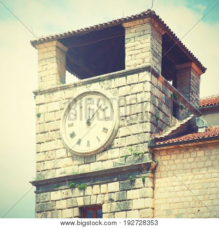 Clock tower in Old town of Kotor, Montenegro. Retro style filtered image