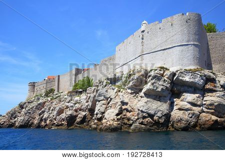 Cliffy coast and fortified city walls of Dubrovnik, Croatia