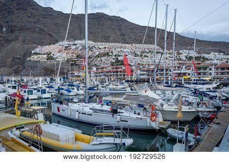 Sailing boats at Los Gigantes resort marina. Tenerife island, Spain.