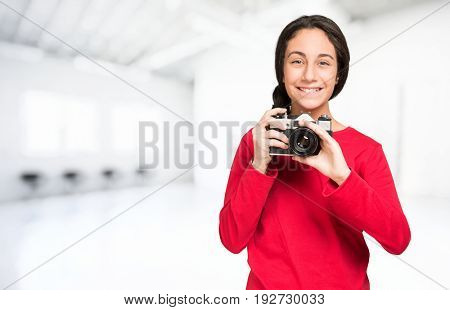 Smiling young photographer, Isolated on white