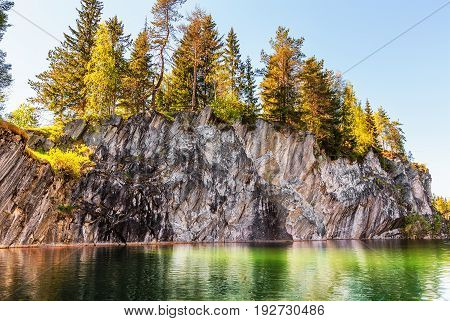 Marble lake in quarry in Ruskeala Park (Russia) in summer day