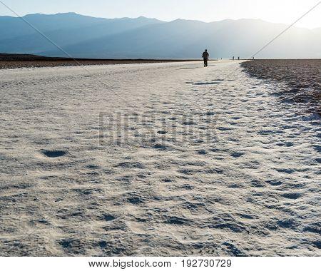 Man Walking At Badwater Basin