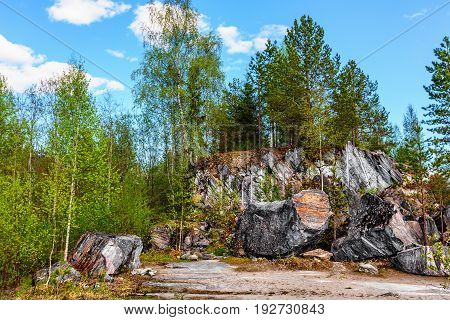 Lumps of rock of white marble in Ruskeala Park in Republic of Karelia (Russia)