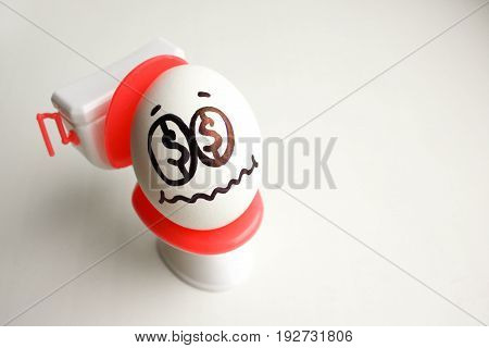 Concept Of Unprofitable Business. An Egg With