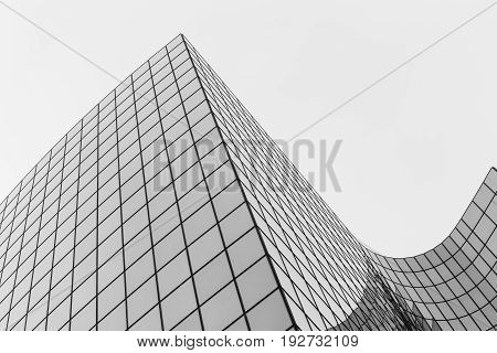 Skyscrapers with glass facade. Modern buildings in Paris business district. Concepts of economics financial future. Copy space for text. Dynamic composition. Toned