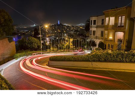 Lombard Street at night with moving traffic