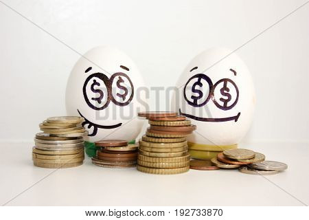 Business Concept Money. An Egg Showing