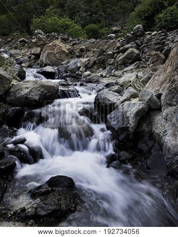 Water flowing in a river creating beautiful small waterfalls at Troodos mountains in Cyprus