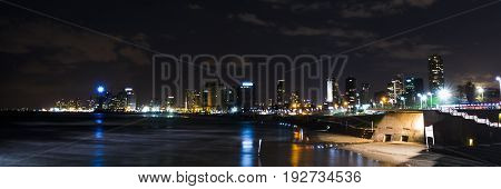 Night panorama tel Aviv photographed from the embankment of ancient Jaffa.