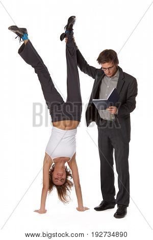 The young man with the book and the girl standing on hands on a white background.