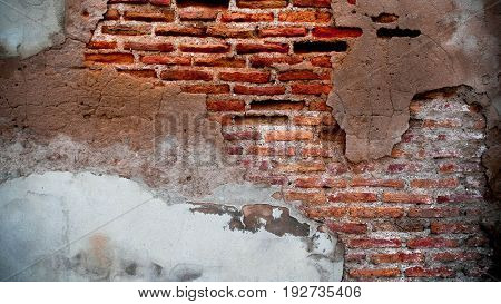 The cement wall have cracked . It's showed about the olded brick of wall. Can be use as background.
