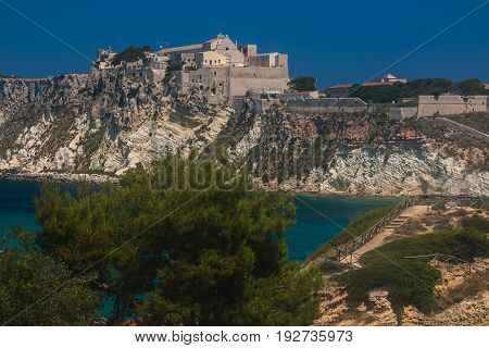A view of San Nicola island from the nearby San Domino island, with the Abbey of Santa Maria a Mare fortified complex