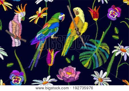 Seamless textile print with colorful parrot, flowers and palm leaves. Stylized embroidered texture. Summer collection.