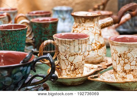 coffee cups and turk brown green with pattern of craquelure is introduced stand on the table