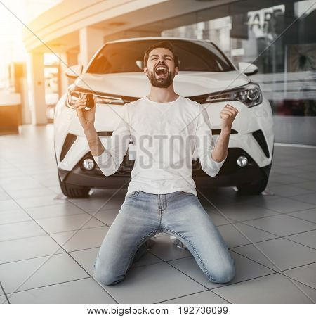 Man In Car Dealership