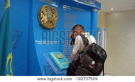 Photographer in the school.Imaging of Kazakhstan State Simbol and Constitution Sary Shagan.Former Soviet  anti-ballistic missile testing range..May 7, 2017.Priozersk.Kazakhstan