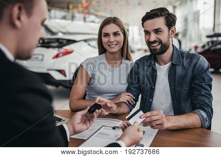 Couple At Car Dealership