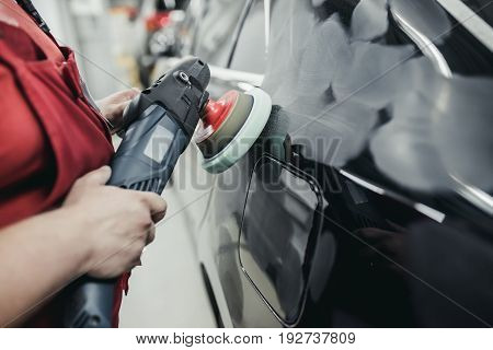 Process of car polishing in auto service. Polishing