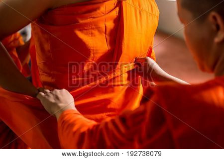 Thai Monk Help To Wear Orange Monk Cloth To Buddhist Man Change Situation To The Monk In Ceremony.