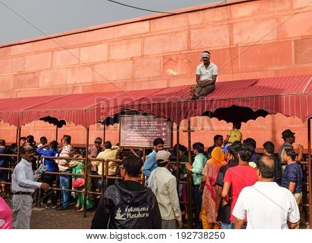 Agra India - April 29 2017: Crowd of indian people waiting in queue to entrance of Taj Mahal west gate Agra India