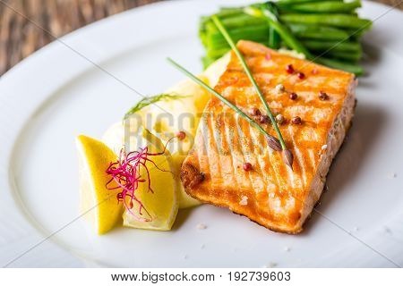 Grilled Salmon. Salmon fillet with lemon and green beans. Grilled fish.