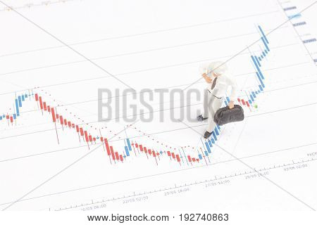 Figure Of Businessman On Financial Charts