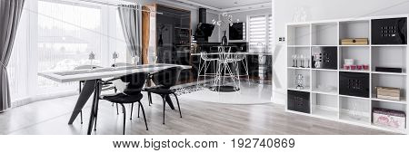 Graphic dining room with modern kitchen annex