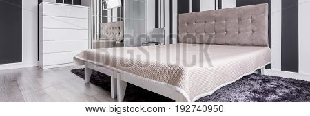 Black and white bedroom in panoramic view