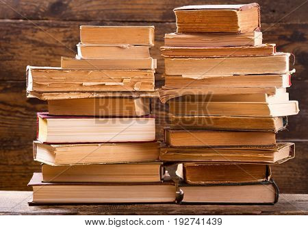 close up of old books on a wooden shelf