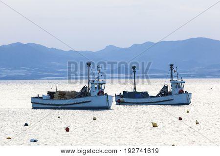 Two fishing boats anchoring at the coast in La Azohia. Region of Murcia Spain
