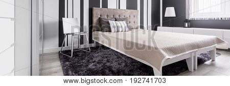 Modern and elegant bedroom in panoramic view