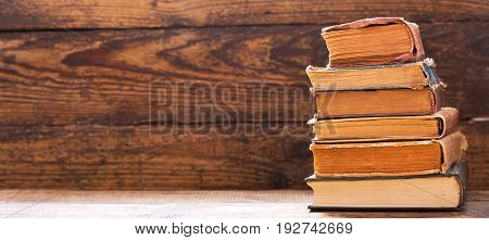 old book on a wooden shelf, banner