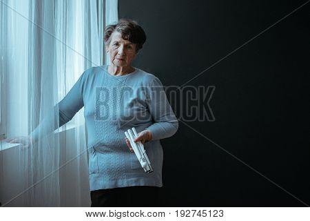 Blind Senior Holding A Stick