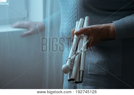 Sightless Person Holding White Stick