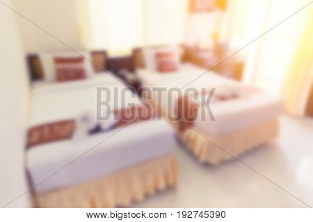 blur hotel bed bedroom double bed white clean hotel room for background.