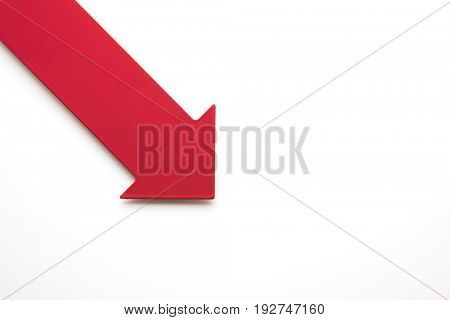Big real red arrow for presentation or slide show. pointing down for decrease or shrink. Natural white background.