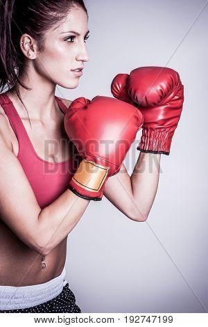 Beautiful female boxer wearing gloves