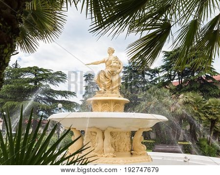 Sochi RUSSIA - May 19 2017: fountain and statue of the goddess of Navigation near the Maritime station in Sochi. The goddess holds the ship and the map in her left hand her right hand calms the excitement of the sea