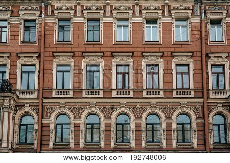 Old beautiful building in Saint Petersburg. Building pattern, many windows and red wall