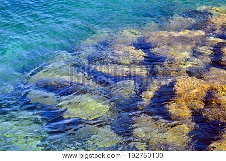Transparent water of the mediterranean sea and stones under the clear water