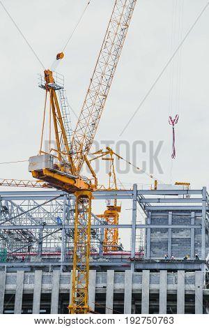 Closeup Crane Hoist Construction On White Sky Background.