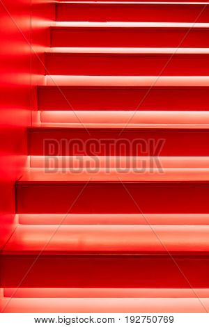 Abstract modern red stairs with warm light - stairway composition