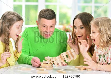 Portrait of a happy family playing with blocks together