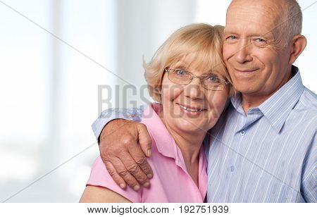 Smiling home couple senior two people senior adult heterosexual couple