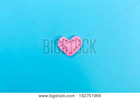 Handmade heart cushions on a blue background