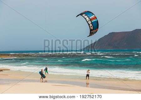 Corralejo, Fuerteventura, April 01, 2017: Unknown Kitesurfers On A Beach In Corralejo, Fuerteventura