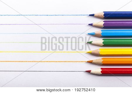 Color row arranged color pencils side by side wooden background real life
