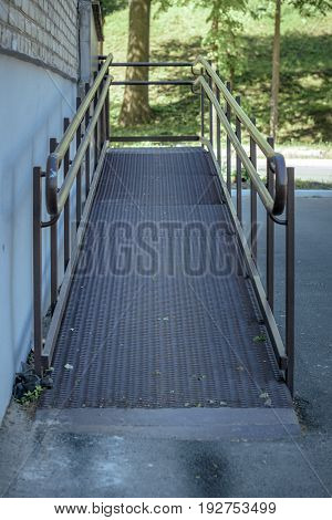 ramp for wheelchairs and the disabled at the entrance to the building
