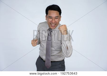 Successful happy business man cheering with his clenched fists,Man is determine